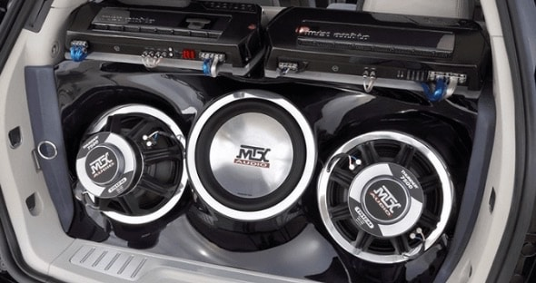 picture of amplifier and subs in car rear