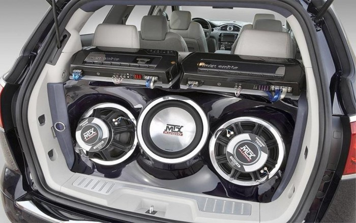 three car subwoofers in the backseat